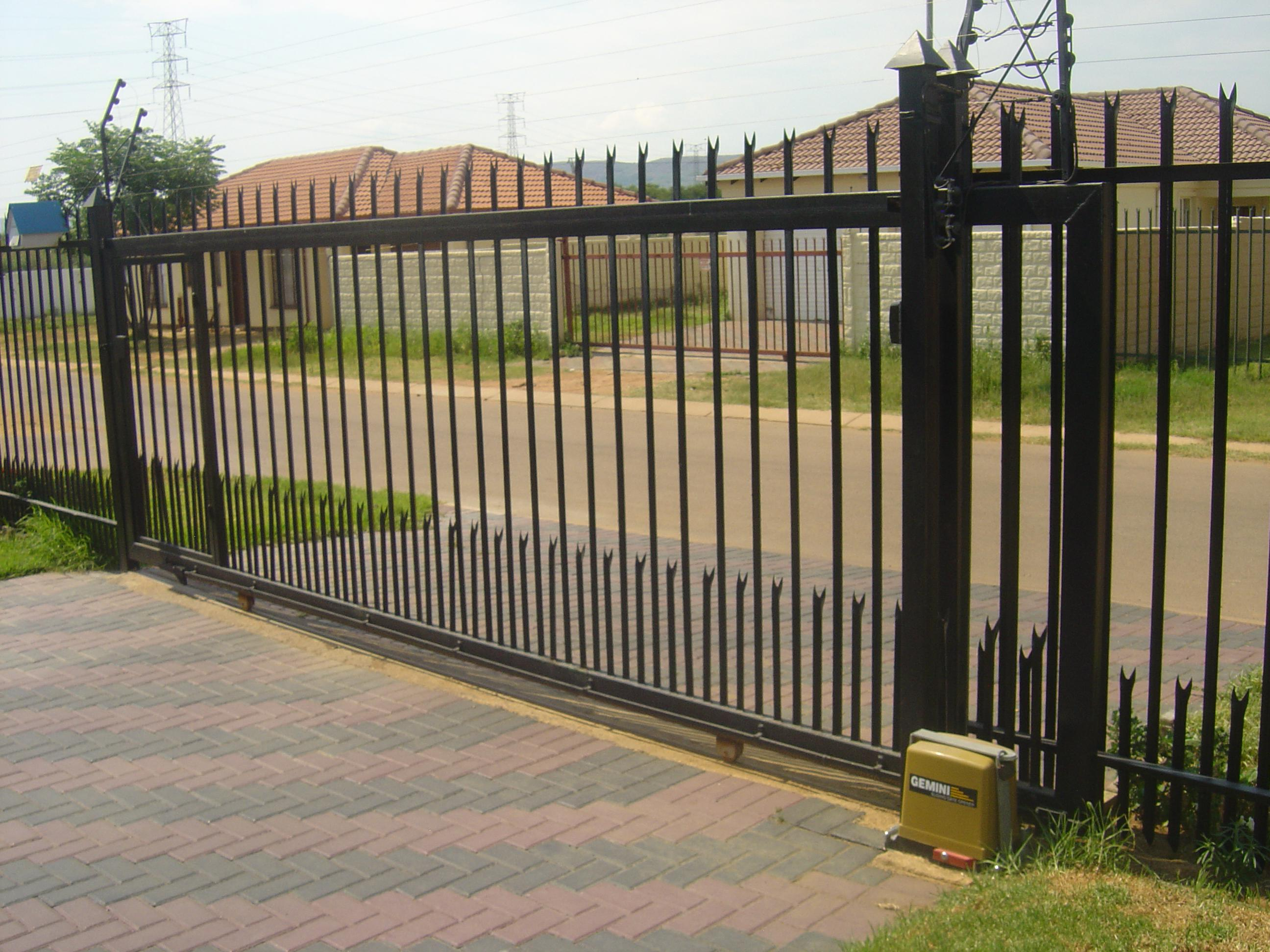 Driveway gates and motors steel security man for Ready made driveway gates